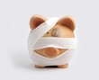 Bandaged piggy bank