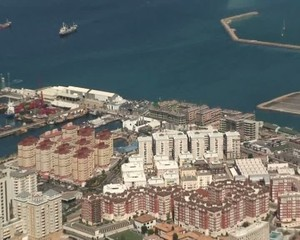 Buildings in Gibraltar zooming out to show town and ocean