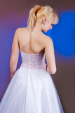 woman in wedding dress standing backwards