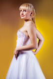 young blonde in wedding dress turned back separated poster