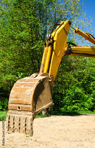 Yellow backhoe from excavator