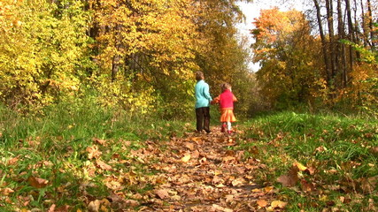 children walking in autumn park