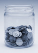 jar of US coins monochrome blue tint