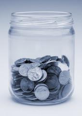jar of US coins monochrome blue tint