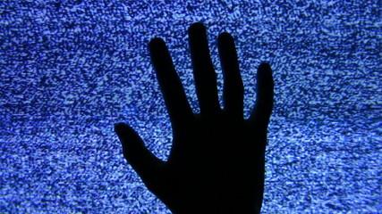 fist hand on tv screen