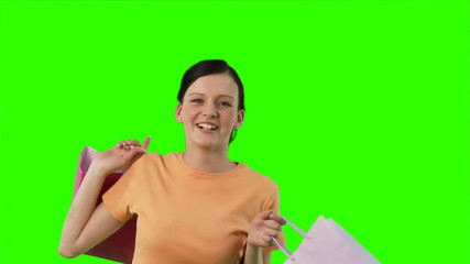 Green screen - Happy girl after buying in shops
