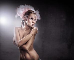 Studio shot of a young, beautiful brunette, fashionable woman