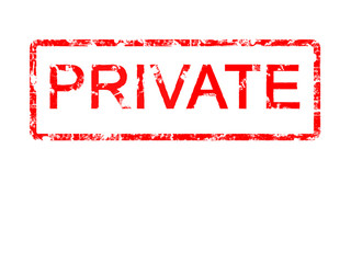 Private rubber stamp, red against white area of copyspace.