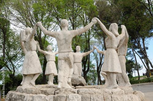 Sardana dancers statue in Barcelona Spain