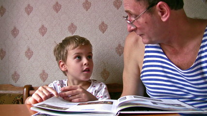 senior with child read book