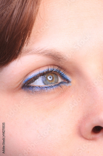 beautiful woman`s open colorful eye