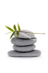 Zen stone balancing with bamboo