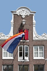 Dutch facade with the national flag in the Netherlands
