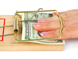 Hand and mousetrap with money