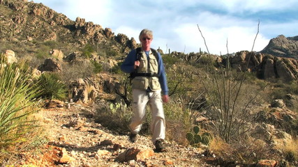Hiker in desert terrain - HD