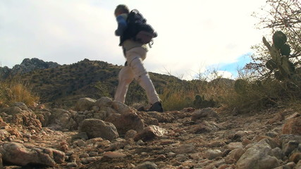 Hiker in desert landscape low ange shot - HD