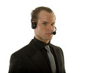 Successful young businessman wearing headphones