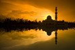 mosque silhouette during sunset with reflection