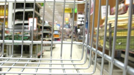 shopping cart in shop, grating