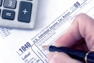 1040 Tax form with pen