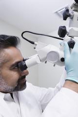Doctor using microscope