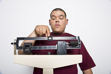 Teenage 16-17 boy using weight scales