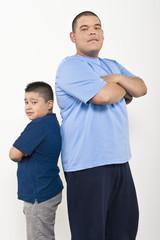 Portrait of teenage 16-17 and pre-teen 10-12 boy