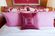 Pink cushions  on bed