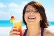 happy woman with colorful cocktail