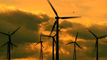 Wind turbines silhouettes at sunset - HD