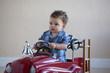 little boy in fire truck