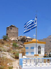 Greek flag, chapel and ancient ruined windmill