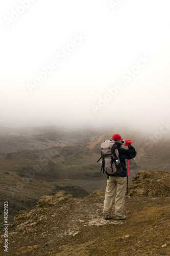 Hiker Taking Photo on Mountain Top