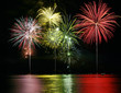 Leinwandbild Motiv Colorful Fireworks over Lake