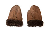 Sheepskin mittens or gloves isolated on a studio background. poster