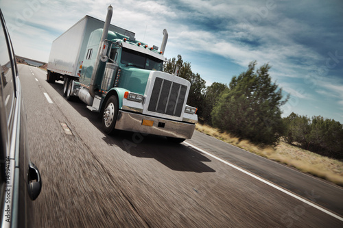 American truck driving on freeway road
