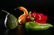Colorful vegetables still over black