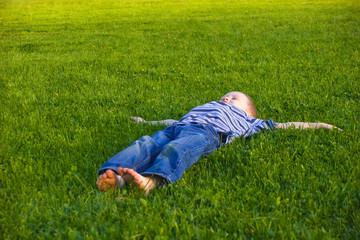Boy lies on a grass