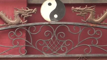 Dragons and Yin Yang Symbol coming into focus