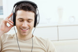 Fototapety Man listening music with headphones