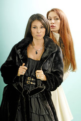two young women in fur coats