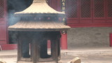 Incense burners smoking, White Cloud Temple, China poster