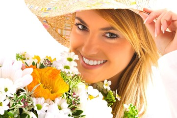 young blond girl with flowers