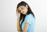 girl with headache in blue T-shirt