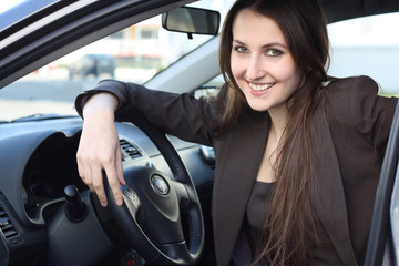 a young woman with her car
