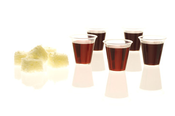 Multiple communion cups with wine and bread