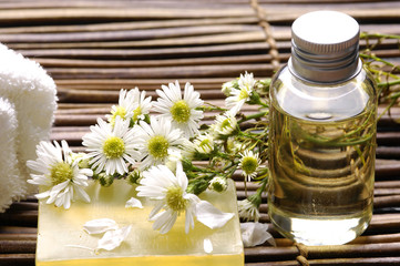 Spa background- towel ,flower, lotion, with soap