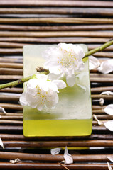 Cherry with soap on bamboo mat