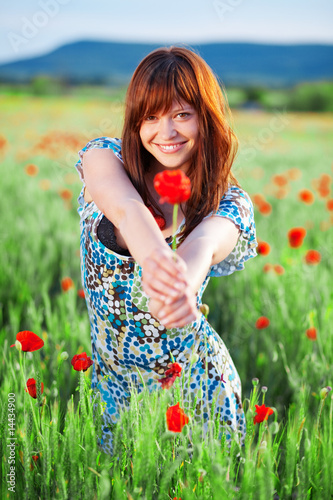 Smiling girl giving flower