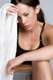 Woman Wiping Sweat From Forehead poster
